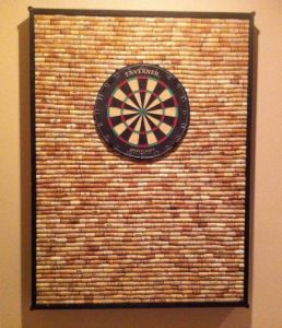 The original idea came from http://aroomofhisown.com/2012/08/27/diy-wine-cork-dart-board/
