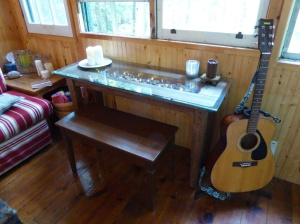 Here is the table with the piano bench. Fits perfectly.