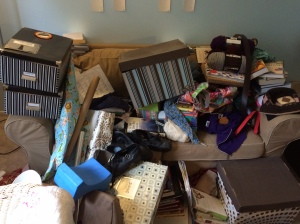 After removing everything off of the bookshelves, I was left with this God-awful mess.