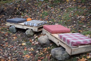 Two simple benches that provide cozy seating around the fire.