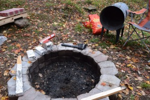 Everything you need to cook your turkey over a campfire - a wooden stake, bricks, lots of tinfoil, at least 2 bags of charcoal, a garbage can and a hammer or hatchet.