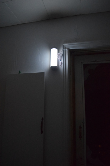 This solar light by the door in the kitchen gives off enough light to see in the kitchen. (The photo is darker than in real life.)