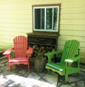 With the addition of the 2nd Adirondack chair, this little patio is really quite charming now.