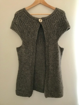 This Shalom cardigan was made from Cascade Yarns Ecological Wool, which is undyed. While it isn't produced locally, the farms treat their animals humanely.